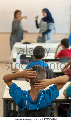 One mixed class with two teachers. Lessons are taught simultaneously in Hebrew and Arabic. - Stock Photo