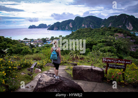 Rear View of Young Woman Looking From Island Viewpoint - Stock Photo
