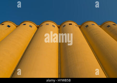 Tower silos facility for grain storage - Stock Photo