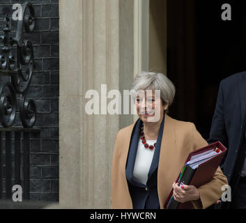 Downing Street, London, UK. 26th April, 2017. Prime Minister Theresa May leaves No 10 to attend Prime Minister's - Stock Photo