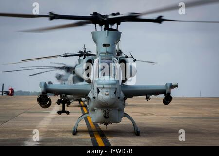 Owinawa, Japan. 26th Apr, 2017. A U.S. Marine Corps AH-1W Super Cobra attack helicopters begin pre-flight checks, - Stock Photo