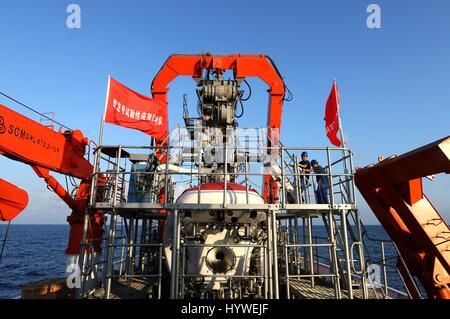 South China Sea. 26th April, 2017.  An oceanaut Tang Jialing enters into China's manned submersible Jiaolong to - Stock Photo