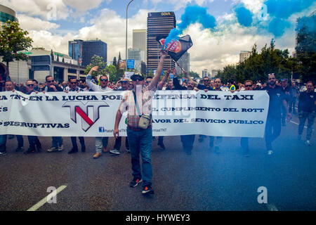 Madrid, Spain, 26th April, 2017. Taxi drivers protesting during a demonstration against private transportation services - Stock Photo