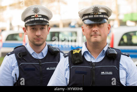 Stuttgart, Germany. 7th Apr, 2017. Two police officers can be seen equipped with different body cameras in Stuttgart, - Stock Photo