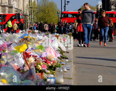 London, UK. 7th April 2017. Parliament Square has been covered with flowers and other tributes to those killed in - Stock Photo