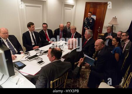 Palm Beach, United States Of America. 07th Apr, 2017. U.S President Donald Trump, center, is briefed by his National - Stock Photo