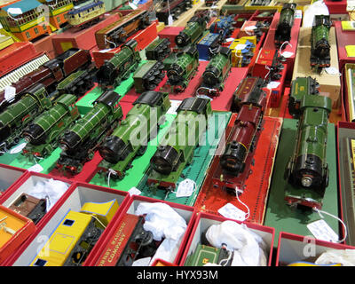 A selection of rare and collectable tin-plate clockwork trains for sale at a Vintage Toy Fair at the Bath & West - Stock Photo