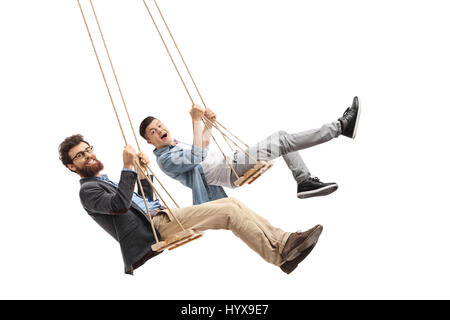 Joyful father and son swinging on wooden swings isolated on white background - Stock Photo