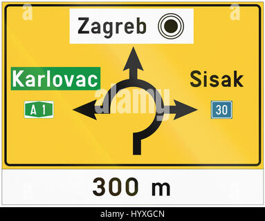 Diagram type direction road sign with roundabout used in Croatia. - Stock Photo
