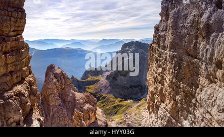 via ferrata, sunny morning in the mountains. Dolomites, green valley. Alps - Stock Photo