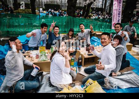 People celebrating Hanami at Ueno Park - Stock Photo