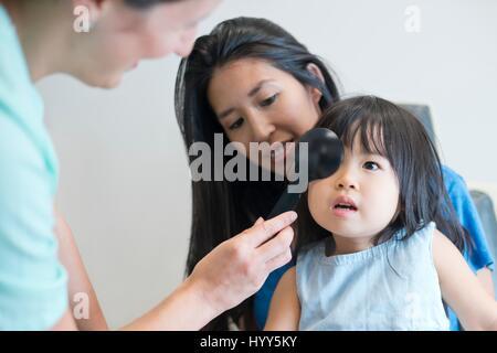 Girl having her eyes tested. - Stock Photo