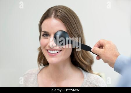 Woman having her eyes tested. - Stock Photo
