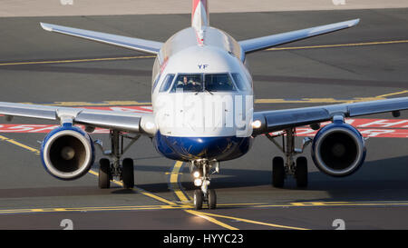 DUSSELDORF, GERMANY - DEC 16, 2016: British Airways CityFlyer Embraer ERJ-170STD airplane taxiing to the gate at - Stock Photo