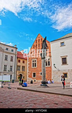 Krakow, Poland - May 1, 2014: Statue of Piotr Skarga on Saint Maria Magdalena Square in the old town of Krakow, - Stock Photo