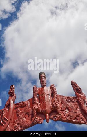 Carved Maori totem poles (pou or pouwhenua) at Waitangi near Paihia in the Bay of Islands, Northland, New Zealand - Stock Photo