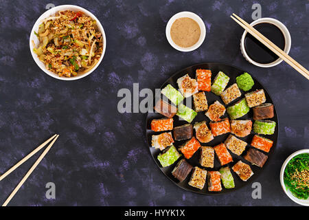 Sushi roll on dark background. Top view - Stock Photo