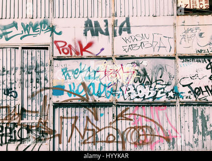 Graffiti wall background. Urban street art - Stock Photo