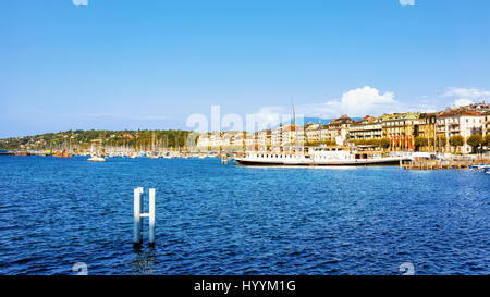 Steamboat on Geneva Lake near Promenade du Lac in summer, Geneva, Switzerland. People on the background - Stock Photo