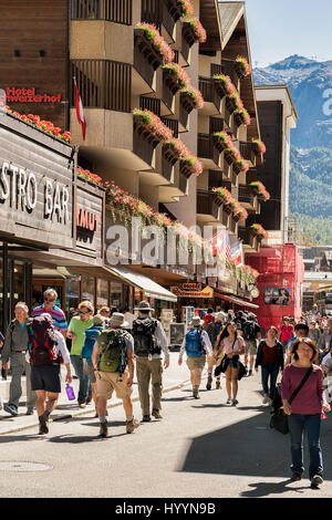 Zermatt, Switzerland - August 24, 2016: Tourists at the city center of Zermatt in summer - Stock Photo