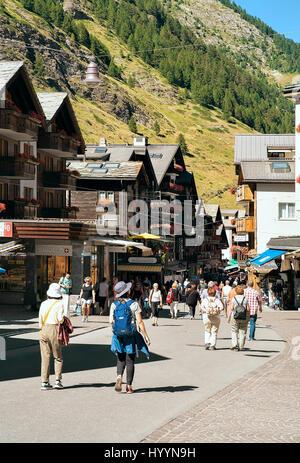 Zermatt, Switzerland - August 24, 2016: Tourists at the town center of Zermatt in summer - Stock Photo
