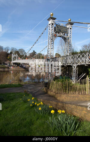 City of Chester, England. Picturesque spring view of Queens Park Suspension Bridge over the River Dee. - Stock Photo