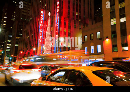 New York City, USA- January 1, 2017: Bright Christmas lights of Radio City Music Hall in New York City at night. - Stock Photo