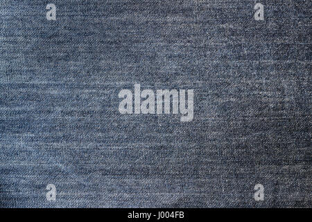Dark blue jeans fabric texture backgrounds with vignette. - Stock Photo