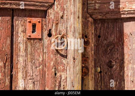 Rusty metal lock on an old wooden door - Stock Photo