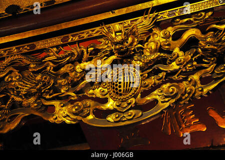 HANOI, VIETNAM - FEBRUARY 19, 2013: The golden interior of the Bach ma temple in Hanoi was decorated in the Medieval - Stock Photo