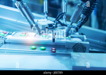 industrial machine robot in assembly line working in factory. Smart factory industry 4.0 concept. - Stock Photo