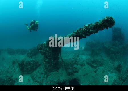 Shipwreck of the Torpedo boat Giuseppe Dezza and scuba diver underwater in the Mediterranean Sea - Stock Photo