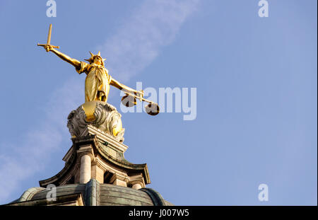 London, England - March 20, 2009: A statue of Justice stands over England's Central Criminal Court on London's Old - Stock Photo
