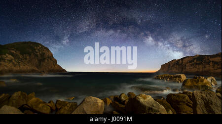 Curved Milky Way over the sea - Stock Photo