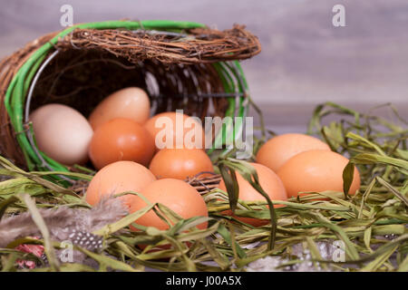 Fresh organic eggs cooking on a wooden background. - Stock Photo
