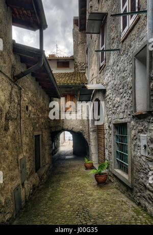 Narrow street in Riva di Solto next to Iseo Lake, Italy - Stock Photo