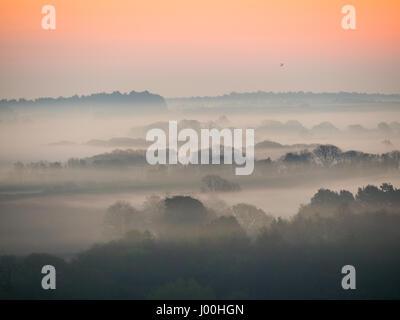Corfe Castle, Dorset, UK. 8th April 2017. Glorious misty crisp sunrise over the Isle of Purbeck looking towards - Stock Photo