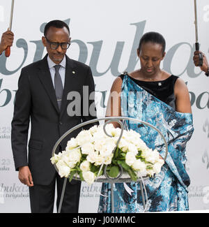 Kigali. 8th Apr, 2017. Rwandan President Paul Kagame and First Lady Jeannette Kagame lay a wreath at the genocide - Stock Photo