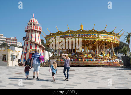Merry-go-round or Carousel and Victorian Helter-skelter Spiral Slide for children in Bournemouth, Dorset, UK
