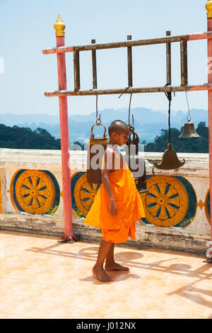 Krabi, Thailand - April 10, 2016: Novice monk observe the hilltop of the Tiger Cave Mountain Temple on April 10, - Stock Photo