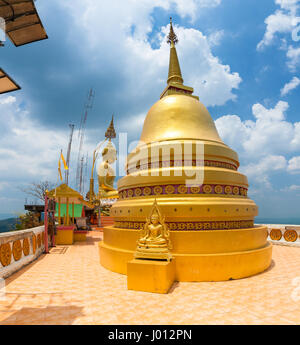 Krabi, Thailand - April 10, 2016: Golden Chedi on the top of Tiger Cave Temple on April 10, 2016 in Krabi, Thailand - Stock Photo