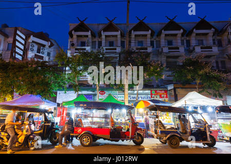 Chiang Mai, Thailand - August 21, 2016: Tuk-tuk taxis wait for customers near Saturday Night Market on August 21, - Stock Photo