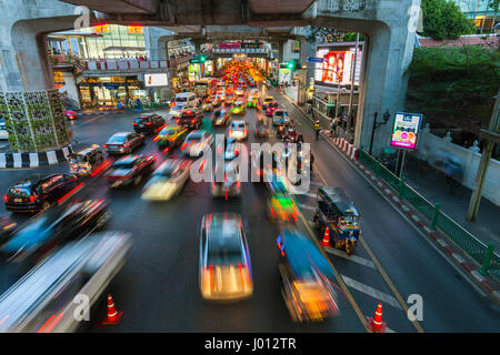 Bangkok, Thailand - April 22, 2016: Cars moving down the road in the heavy traffic conditions at Siam Square on - Stock Photo