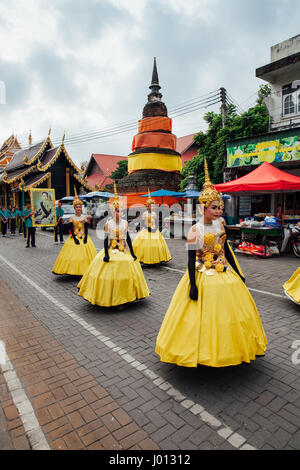 Chiang Mai, Thailand - August 24, 2016: Young girls in festival costumes parade near the ancient temple on August - Stock Photo
