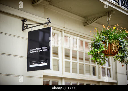 Sign outside Marco Pierre White's Steakhouse, Bar & Grill in Windsor - Stock Photo