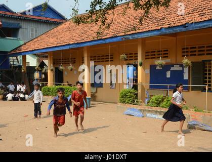 Children in the playground, Elementary School, Kampong Tralach, Phnom Penh, Cambodia - Stock Photo