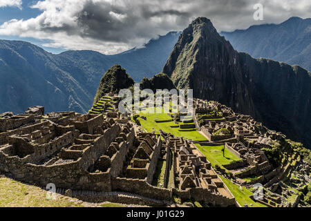 Panoramic view from the top to old Inca ruins and Wayna Picchu, Machu Picchu, Urubamba provnce, Peru - Stock Photo