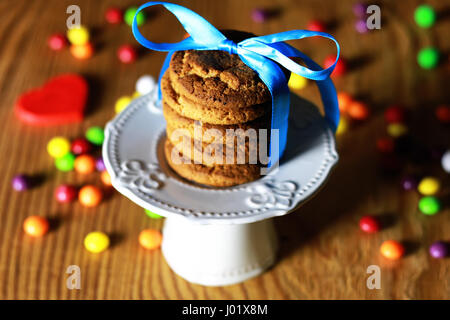 cookies with ribbon on plate - Stock Photo