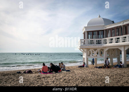 Cadiz Spain- April 1: Caleta beach in the middle of the old city is the most popular of the beaches, Group of young - Stock Photo
