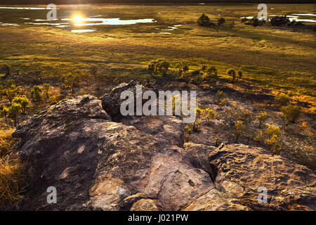 Dusk at Ubirr rock looking down at the sun reflected in the waters of the Nadab floodplains. Northern Territory, - Stock Photo